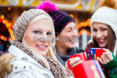 woman drinking eggnog on german christmas