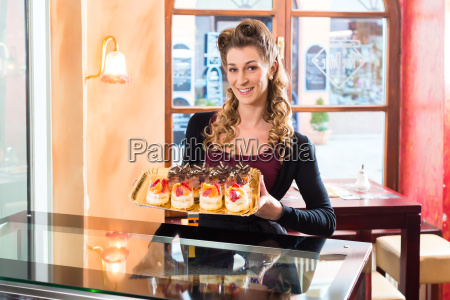 female baker in confectionery