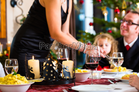 family, having, christmas, dinner, sausages - 21479167