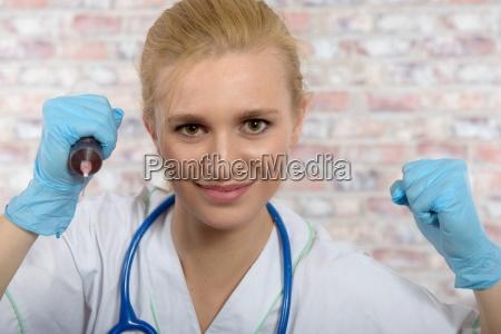 young nurse with a big syringe