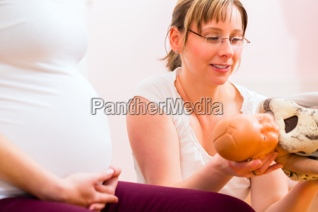midwife giving prenatal care for pregnant