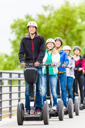 tourist group driving segway at sightseeing