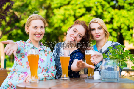 friends talking and drinking in beer