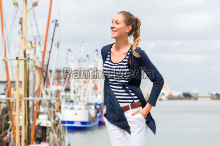 woman standing at harbor pier
