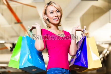 asian young woman shopping fashion in