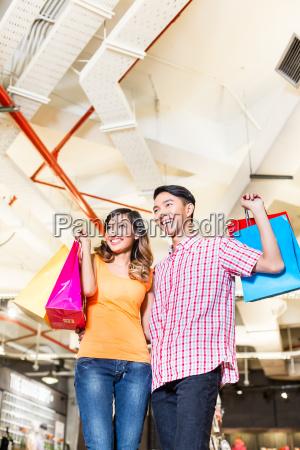 asian couple shopping in fashion store