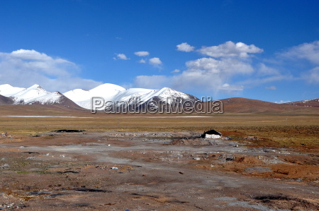 tibetan plateau with snow capped mountains