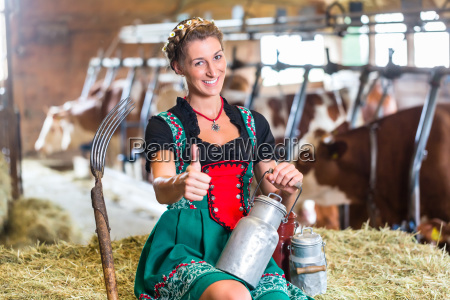 sexy countrywoman in cowhouse