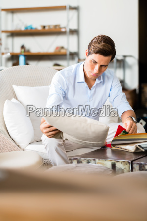 man choosing colors and material for
