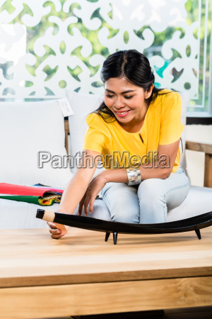 asian woman on sofa couch in