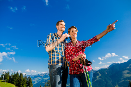 couple enjoying view hiking in the