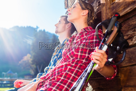 couple resting from nordic walking in