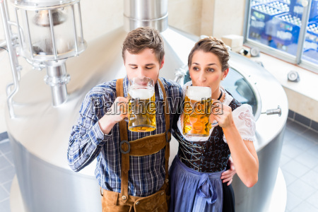 brewer and woman toasting in beer
