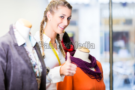 small business owner dressing shop window