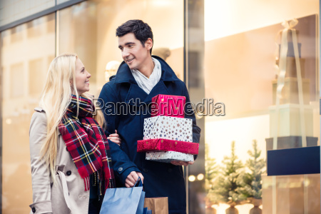 woman and man with christmas presents
