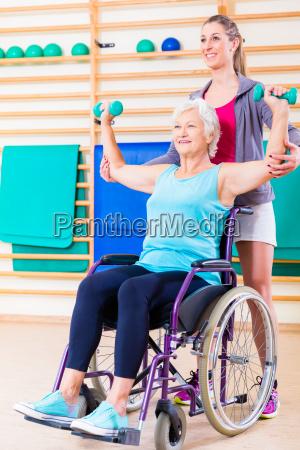 senior woman in wheel chair doing