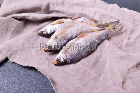 three withered roach fish on the