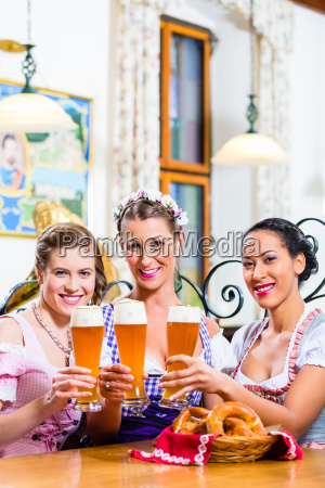 group of people with wheat beer