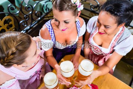 people drinking beer in bavarian pub
