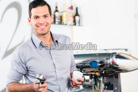 young man posing near a modern