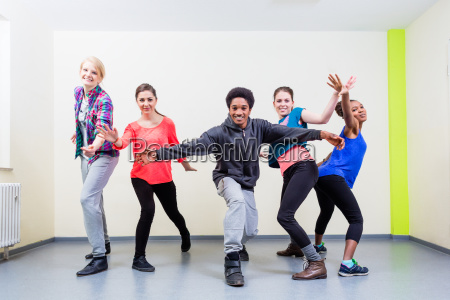 group of young people having dance
