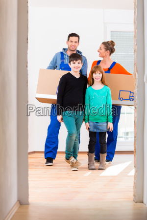family with boxes moving in new