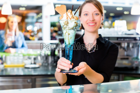 saleswoman in ice cream parlor presenting