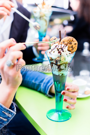 couple enjoying an ice cream sundae