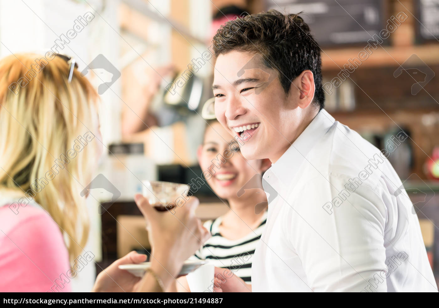 People Having Coffee And Fun In Asian Cafe Stock Photo 21494887 Panthermedia Stock Agency