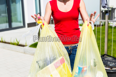 woman throwing the garbage away in
