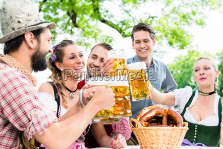 clinking glasses with beer in bavarian