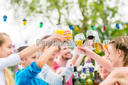 friends and neighbors toasting on garden