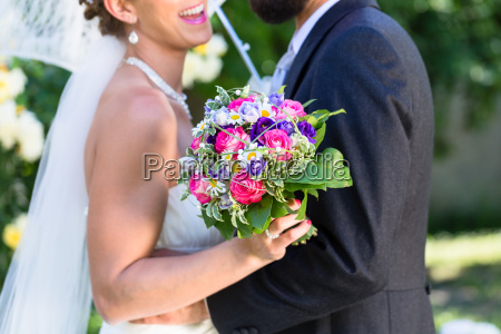 bridal couple embracing each other in
