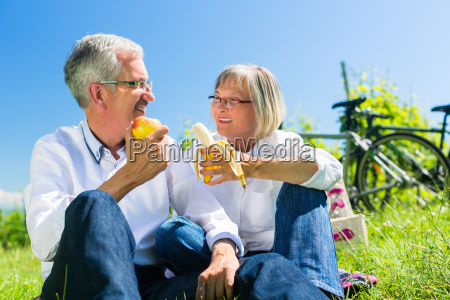 senior couple eating and drinking at