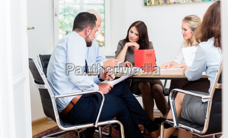 lawyers in law firm reading documents