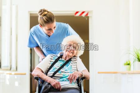 caregiver with senior patient in wheel