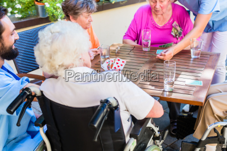 group of seniors and nurse playing