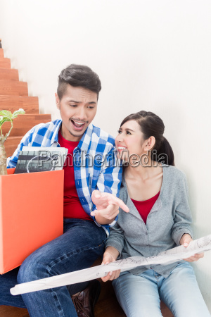 asian couple with ground plot planning