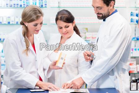 team of pharmacists in drug store