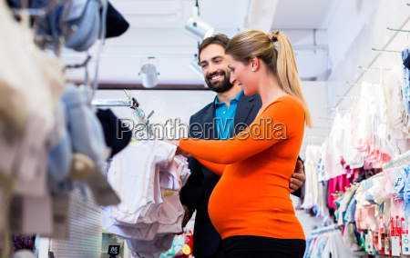 pregnant woman and man buying baby