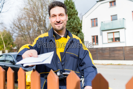 mailman passing letters to addressee over