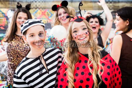 boy and girl dresses as ladybird