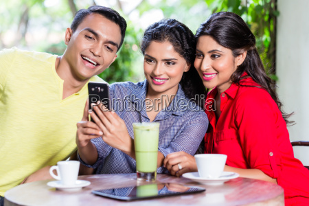 indian girl showing pictures on phone