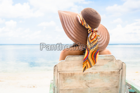 female tourist relaxing in deck chair