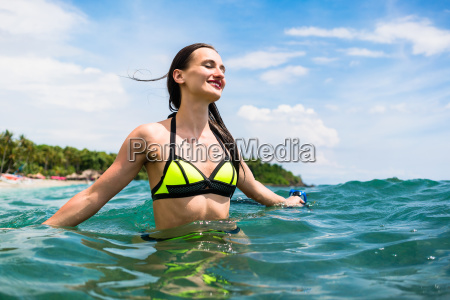 girl with diving goggles in sea