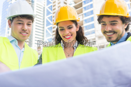 architects with ground plot on construction