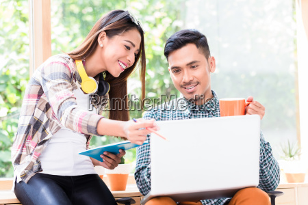 two young asian employees working together