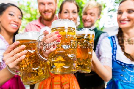 friends in beer garden with beer