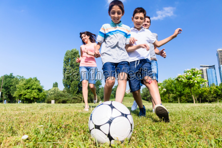 family playing football or soccer in
