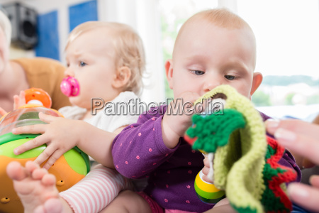 babies with pacifier in toddler group